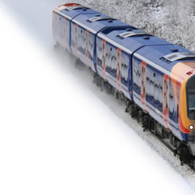 de-icer in use on a rural train route in the snow