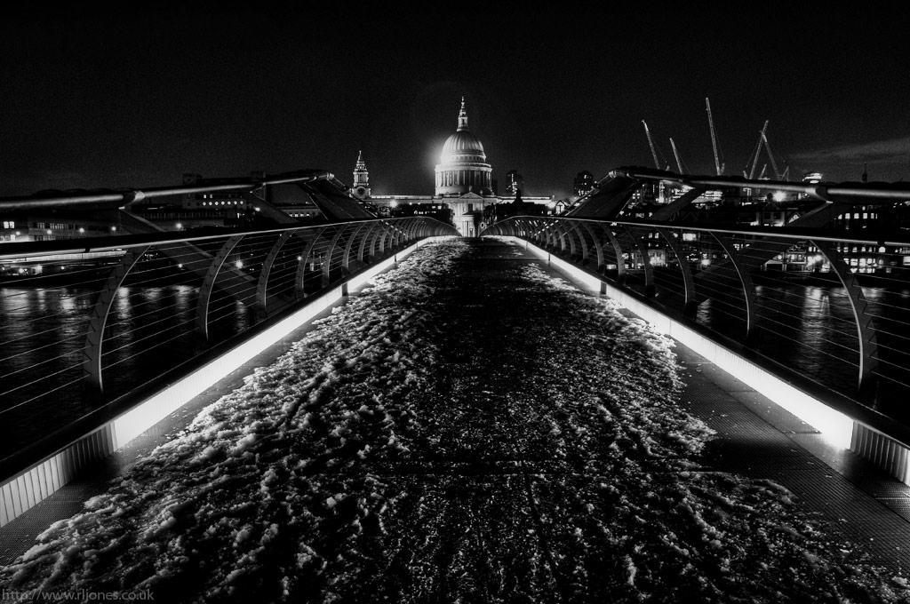 An icy night time view of London's St Paul's Cathedral, taken from the Millennium Bridge