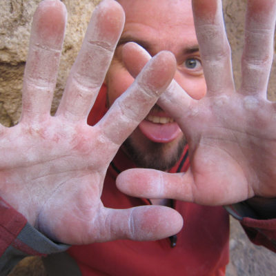 A worker holding his hands up to show his palms covered in white dust