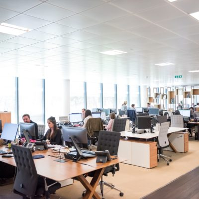 Team of people working in an open plan office